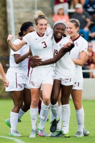 Megan Connolly (#3) celebrates with teammates after a goal, 2015
