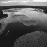 An aerial view around dusk, overlooking the northern end of Lake Iamonia near the Fl-Ga state line, as a small boat heads east from the boat ramp