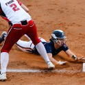 A member of the USSSA Pride slides into base during a game in Tallahassee versus the Scrap Yard Dawgs
