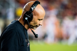 Def. coordinator Charles Kelly hangs his head after the Leggett leap