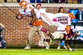 Leggett leaps over an FSU player for a Clemson touchdown
