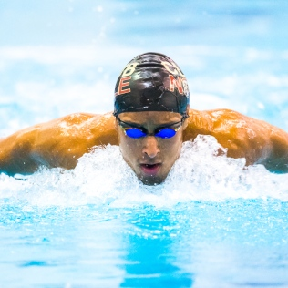 Juan Sequera swims butterfly, on day #1 of the 2017 Mac Crutchfield Invitational